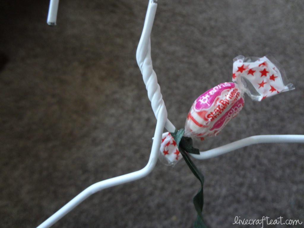 wire hanger, candy, floral tape