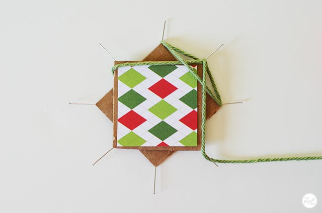 step 5 for how to make a faux-woven christmas star using string/yarn.