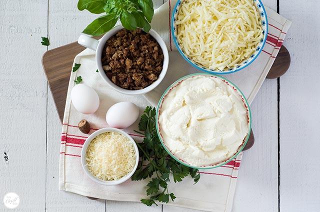 italian sausage, mozzarella, ricotta, parmesan, eggs, parsley, basil, nutmeg